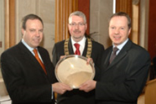 Economy Minister Nigel Dodds pictured with John Fowler, Chairman of the Belfast Branch BCS, presenting the BCS annual award for contribution to the IT industry to David Mawhinney, Managing Director of ICS Computing Ltd
