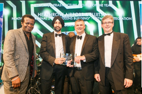 Heathrow's Director of IT Programme Delivery, Bally Grewal collects the award with Fujitsu Senior Project Manager Alasdair Penman (centre)